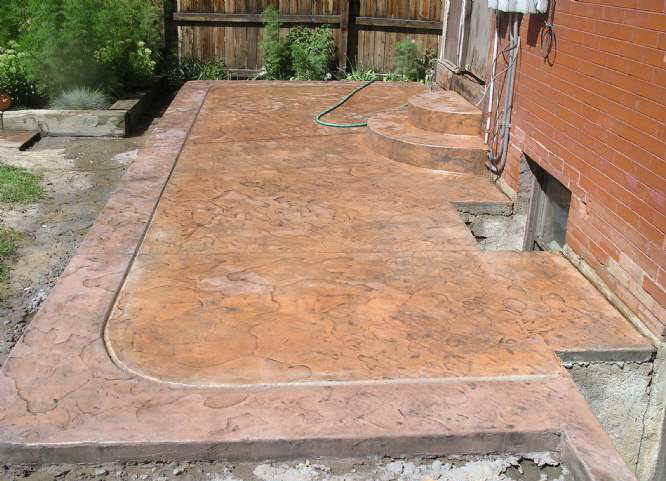 Your Denver Metro Construction Extended concrete patio with color & Stamp